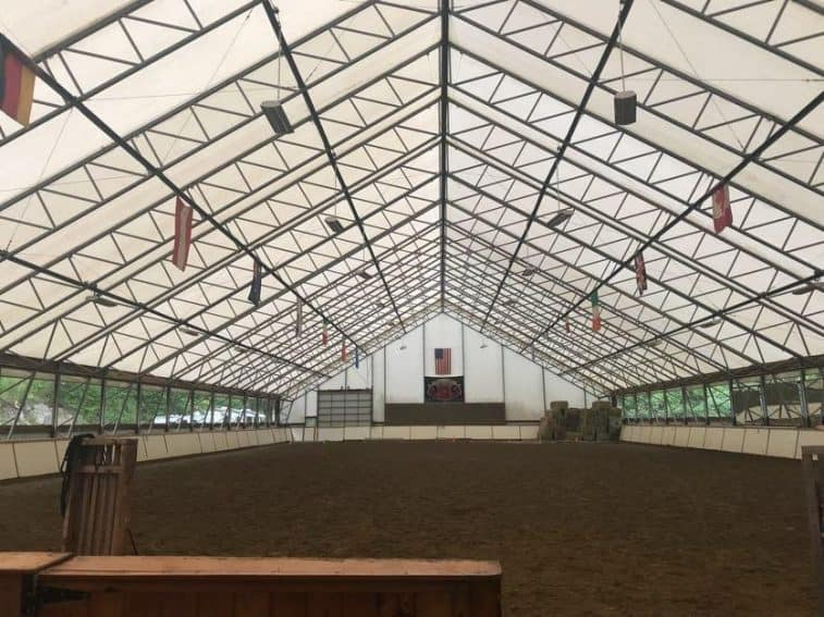 The inside of the arena where the Friesians take part in a performance.
