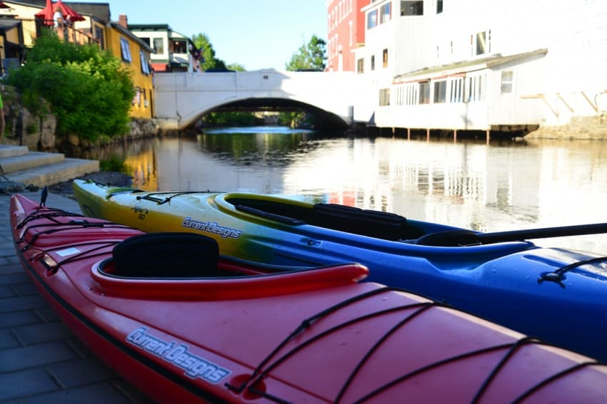 Kayaks already await paddlers on Saranac River in downtown Saranac Lake.