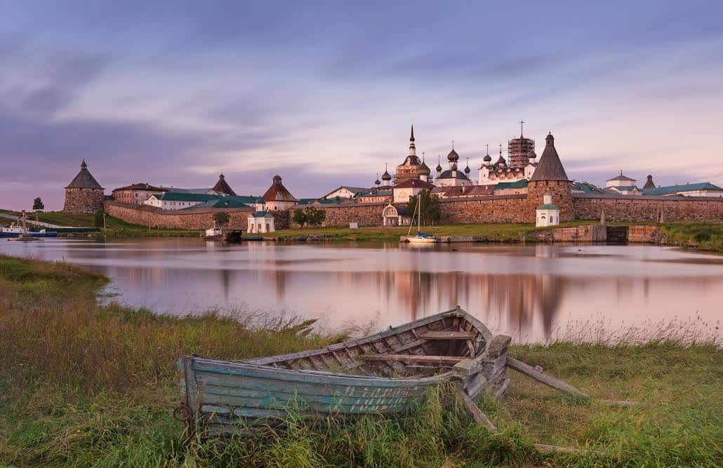 A classic scenic view of the Solovetsky Spaso-Preobrazhensky Transfiguration Monastery, and the big, old boat from the white sea side.