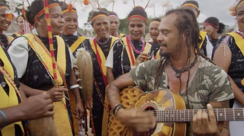 Franti performing for a village.