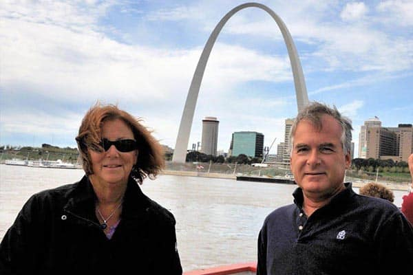 The author and his wife on a cruise down the Mississippi river, near the Gateway Arch.