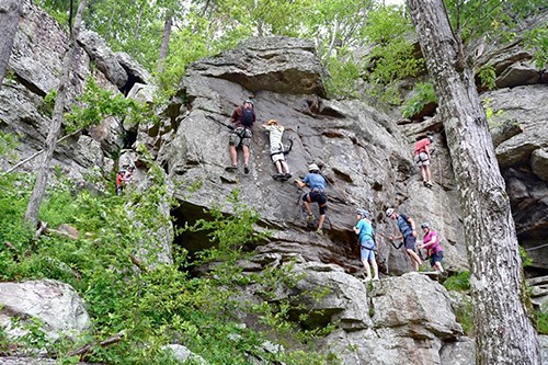 Climbers climbing the different routes at HCR. Photo by Horseshoe Canyon Ranch Adventures.