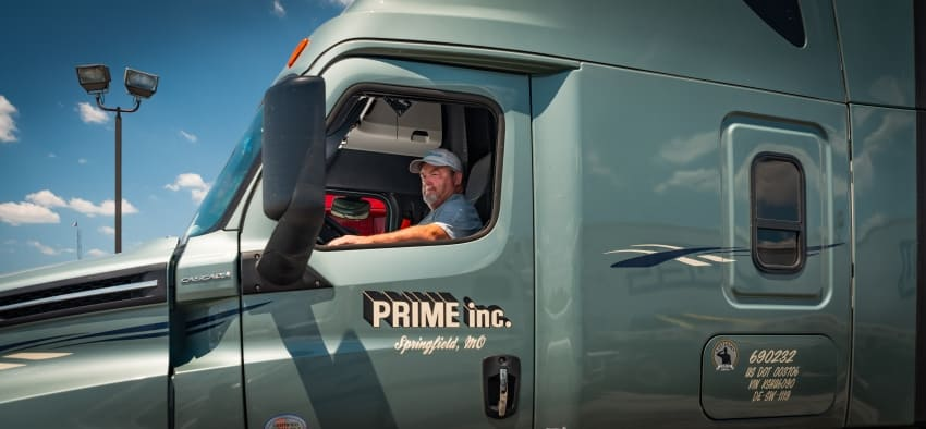 Trucker Scott Monaghan taking a mandatory 30-minute break in his rig.behind the wheel of his 18-wheeler.