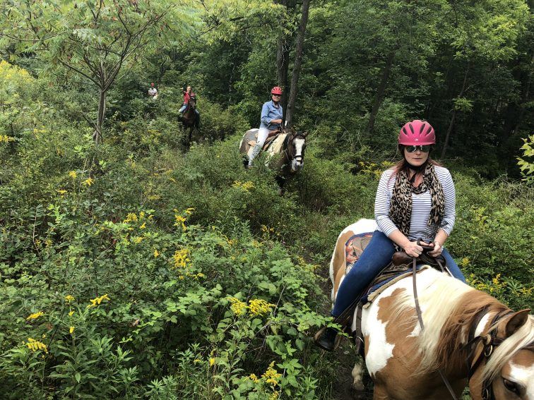 Trail riding outside of Watkins Glen, NY at Painted Bar Stables.