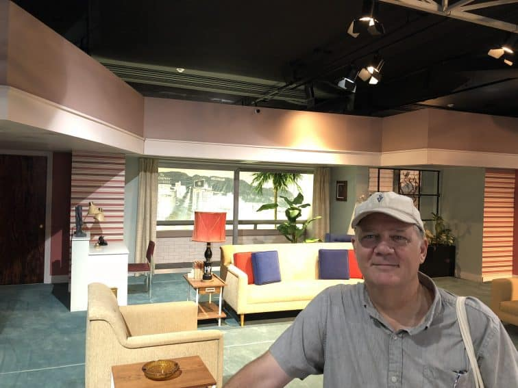 """Standing in front of the set used for the Hollywood episodes of """"I Love Lucy,"""" at the Lucy and Desi Museum, Jamestown, NY."""
