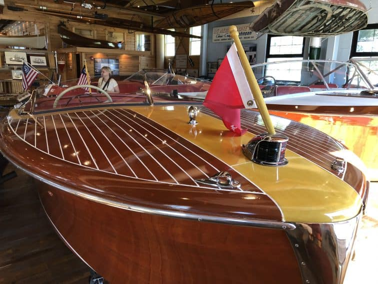Antique Chris-Craft wooden motor boats on display at the Lawson Center in Bemus Point, New York.