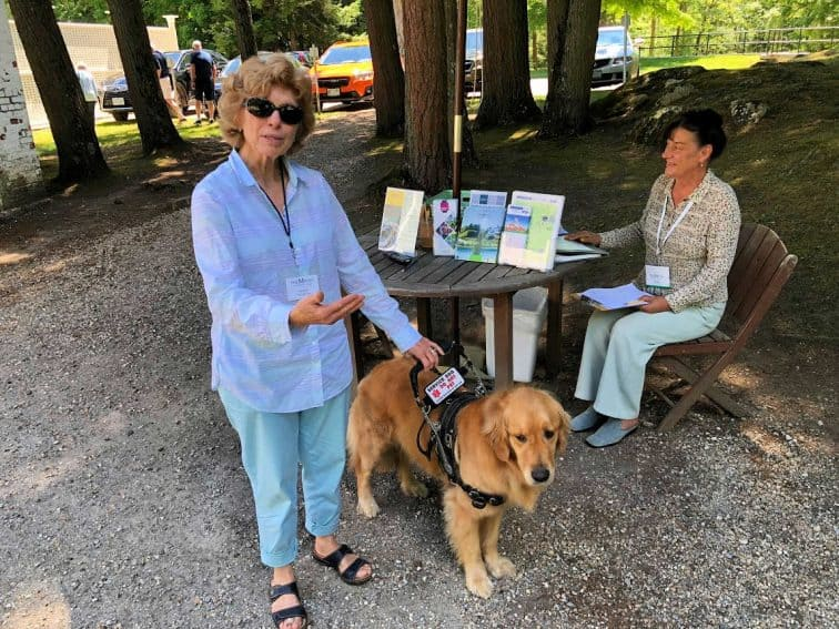 Laurie Foote, the docent at the Mount with her service dog.