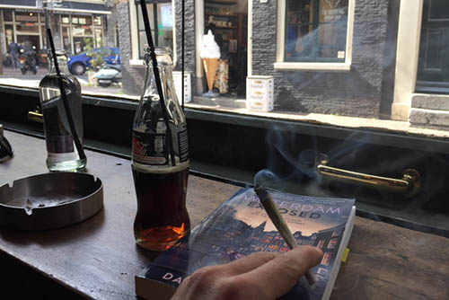 Inside an Amsterdam brown cafe with a joint