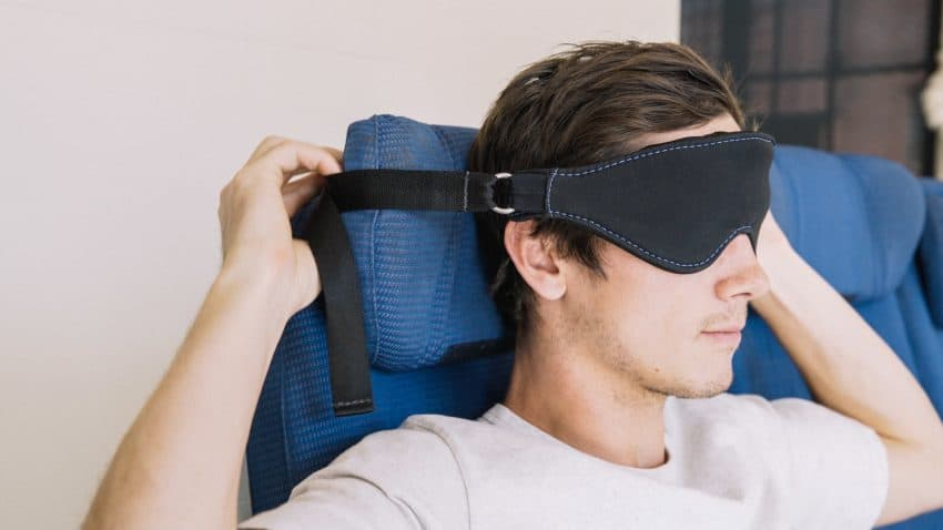 Seatdreamzzz mask that connects to the headrest to keep your head straight.