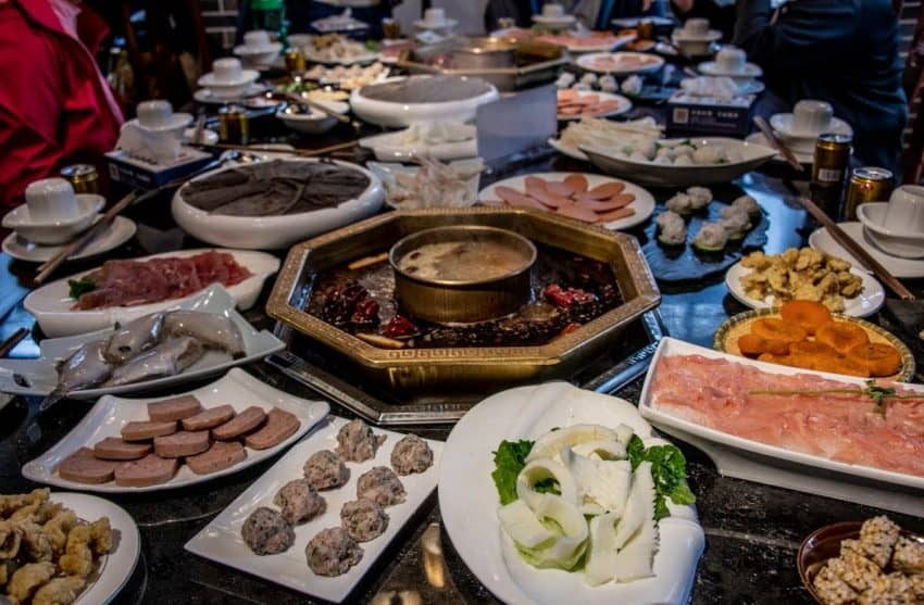 Chongqing is famous for hot pot, where a boiling spicy broth is used to cook a variety of animal parts, such as tongue, brains and stomach linings of cows. Hot pot, China, GoNOMAD Travel