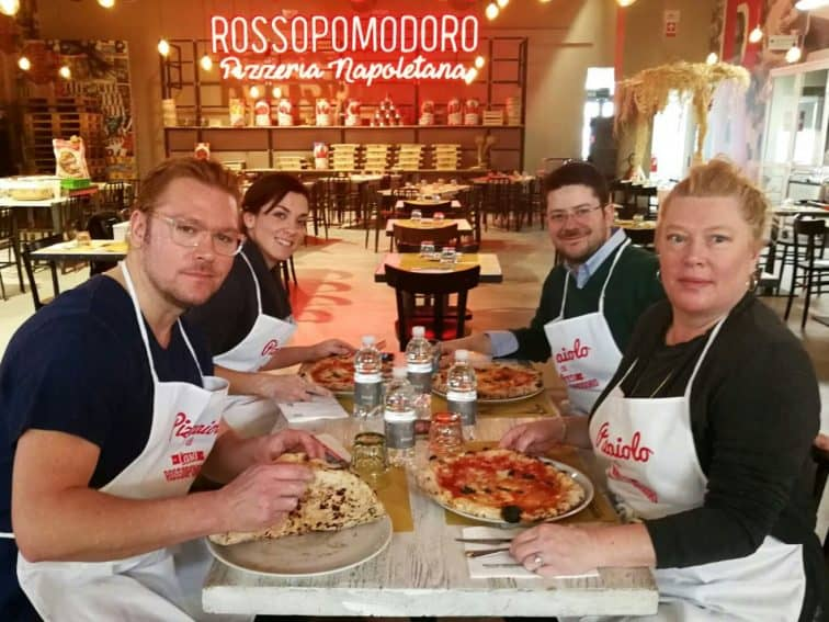 The author enjoying the savory goods after a cooking class at FICO Eataly World is an unforgettable, delicious highlight.
