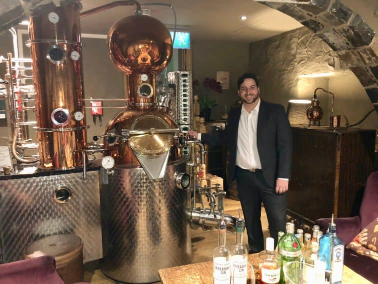 Bruce Marques shows off Luke Wheadon's gin-making still.