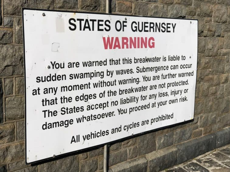 The sign warning people about high winds on the breakwater at St Peter Port.