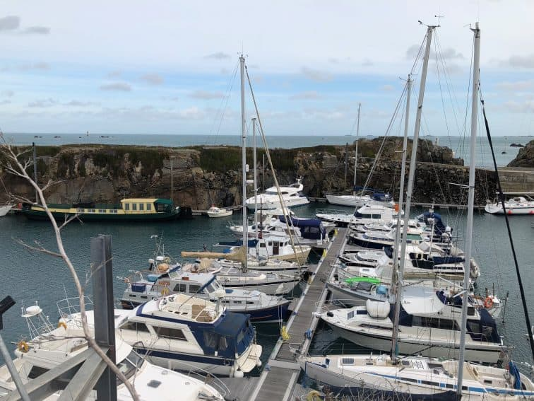 Sailboats in the protected harbor at St Peter Port, Guernsey.