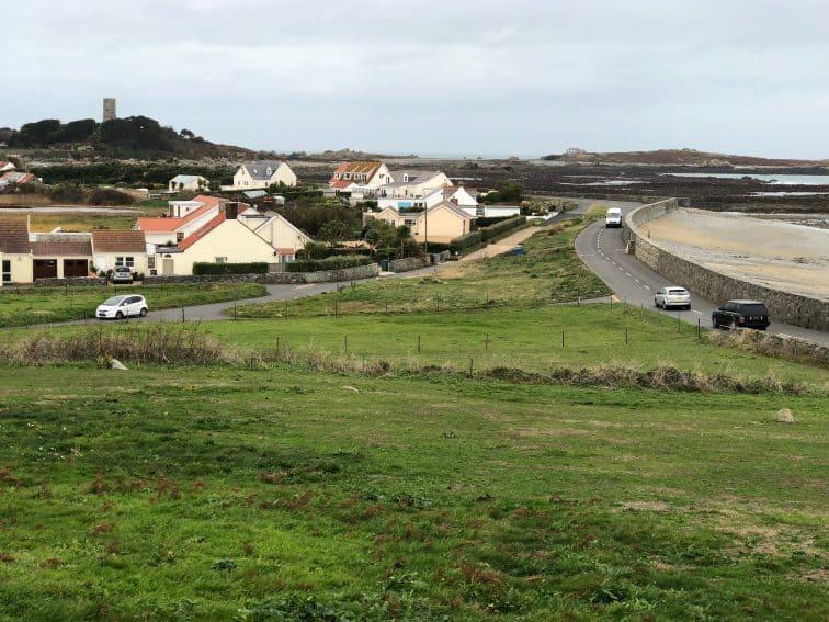 Roadside scene showing the seawalls in Guernsey.