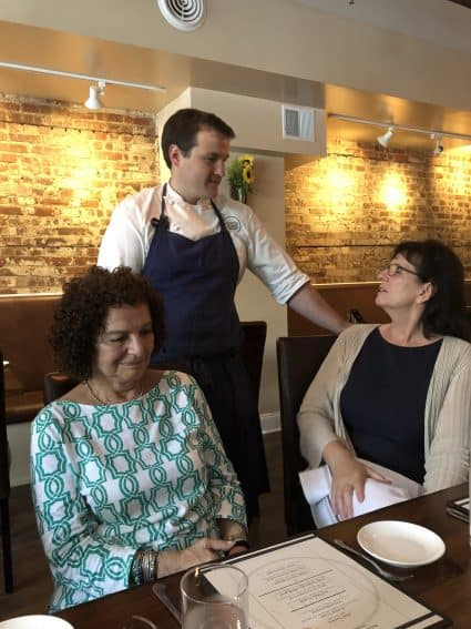 Chef Michael Kelly with customers at Liberty Street Bistro in Newburgh, NY.