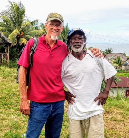 """Philipe Flores, the unofficial """"mayor"""" of the Garifuna Town, gives informal tours to visitors that usually end up here in the Garifuna Town community center."""