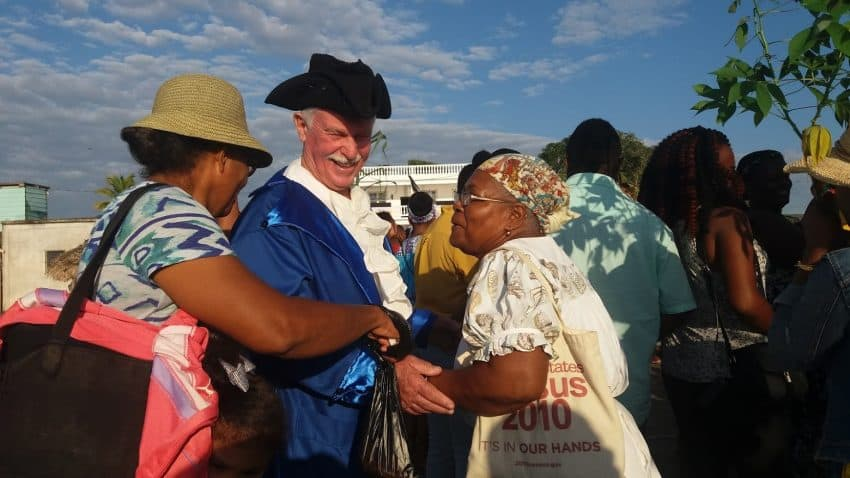 """Punta Gorda residents greet the local actor who played the """"British official"""" in the annual historic portrayal of Garifuna Settlement Day on the pier in Punta Gorda, Belize."""