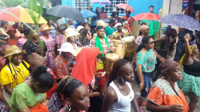 Throngs of happy Garifuna marchers play their native drums, chant and sing in the streets of Livingstone, Guatemala -- rain or shine -- on Garifuna Settlement Day.