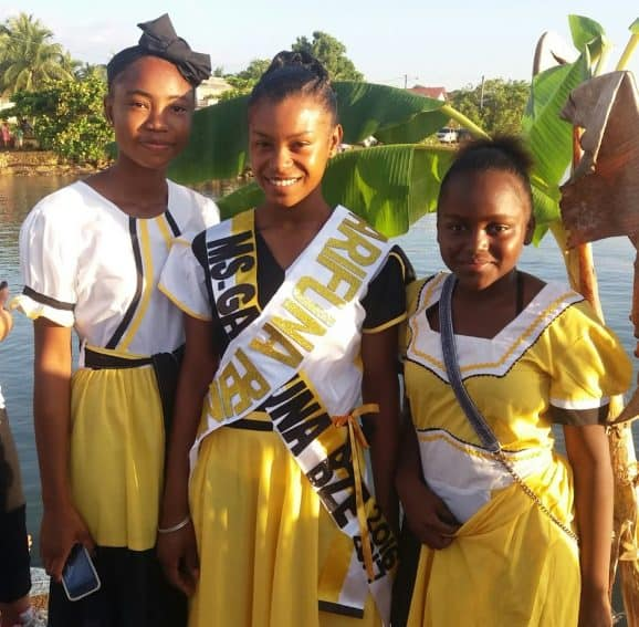 Miss Garifuna Belize 2016-17 and her court pose on the pier at reenactment ceremonies