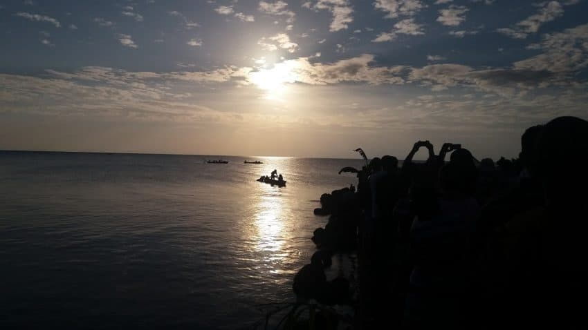 A Garifuna boat with would-be settlers awaits a signal to come ashore in the early dawn light during the annual reenactment of Garifuna Settlement Day offshore Punta Gorda, Belize, Nov. 26, 2016.