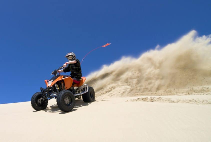 Teen riding ATV in Oceano Dunes State Vehicle Recreation Area