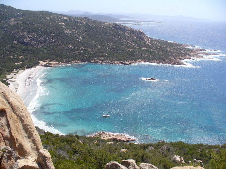 Cliffside view of the serene Roccapina Beach in Corsica