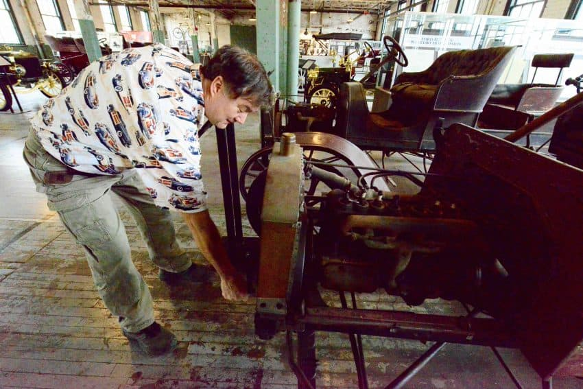 Birthplace of a revolution, the first 12,000 Model T's were assembled in the Piquette Plant and shipped out by railroad. George can't help but tinker a little with the hand crank.