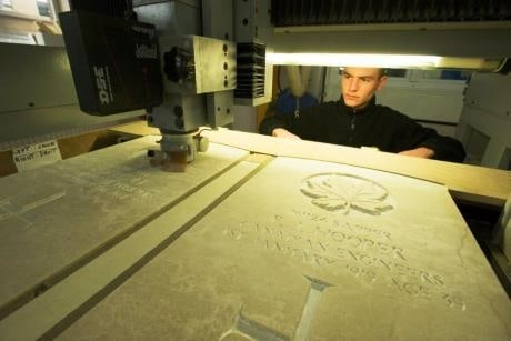 Worker refurbishing a headstone at the Commonwealth War Graves near Arras.