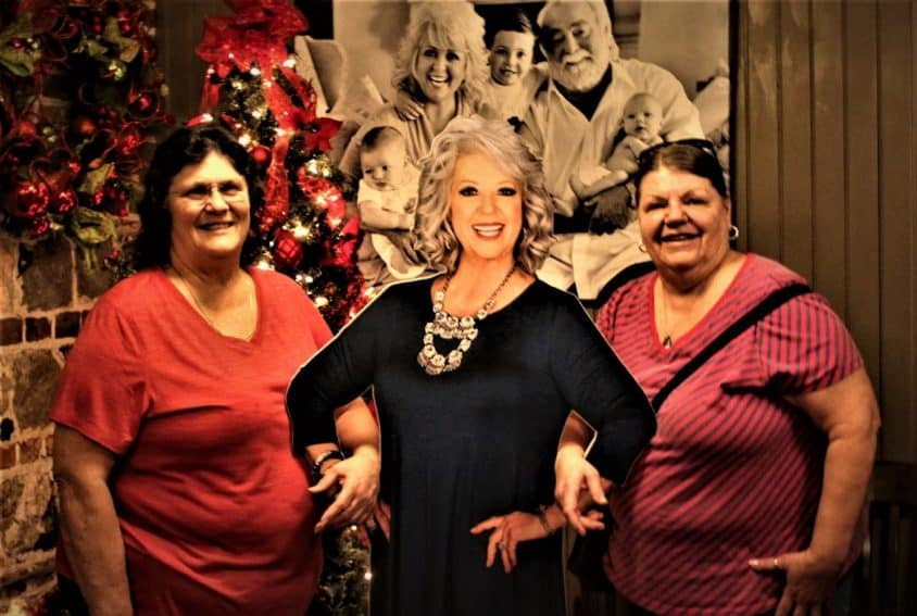 Patsy Holman, left, and Lynn Ring stand next to Deen cutout.