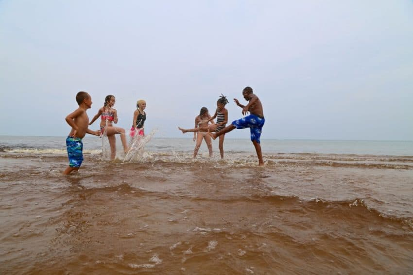 Enjoying the beach at Indiana Dunes National Park, the nation's newest park. Indianadunes.com photo.