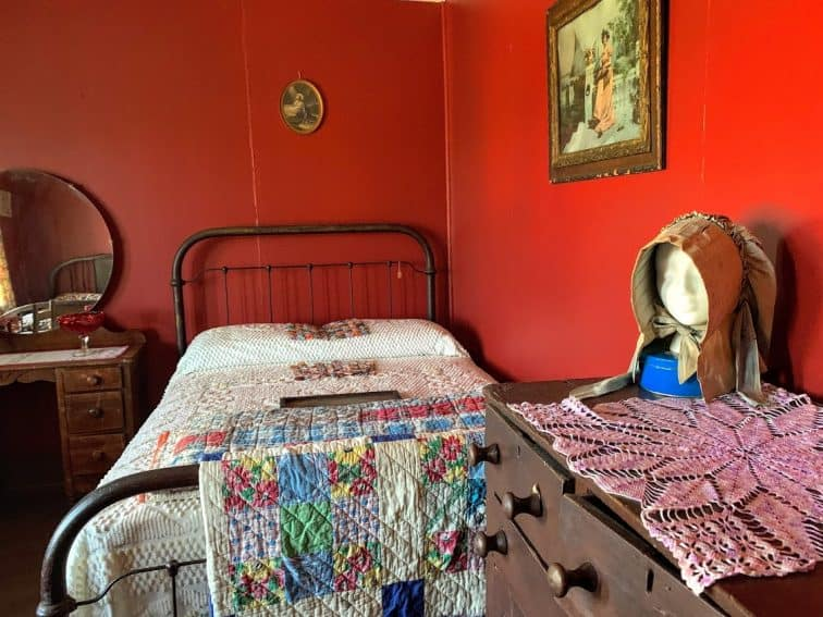 One of the girl's bedrooms has a handmade quilt and crocheted doily. Tennessee