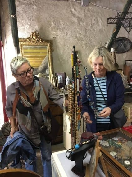 Sandy and Mary examine jewelry at the local brocante (secondhand shop) in the nearby village of Bize-Minervois.