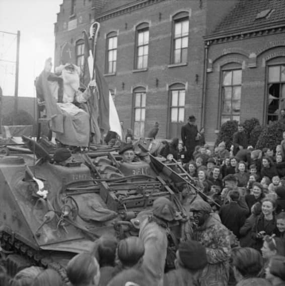 A photo from December 6th 1944, when Sinterklaas (Santa Claus) arrived with a Sherman ARV in Rucphen.