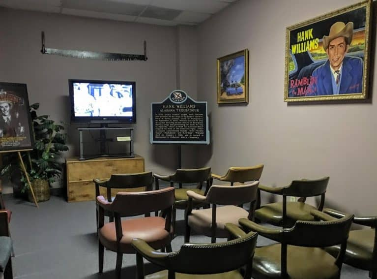 A small room lets visitors watch video performances by the legend.