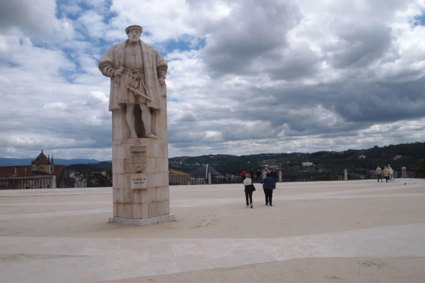 The University of Coimbra is famous for this huge square with the imposing statue of King Joao III in the middle. Max Hartshorne photo.