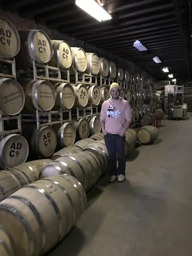 John Curtain shows off his impressive store room. Each barrel is made from oak, a requirement by law when making whiskey.