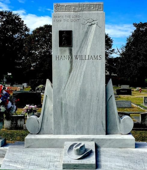 """""""Praise the Lord, I saw the light,"""" is engraved on Hank William's tombstone in Montgomery Alabama."""