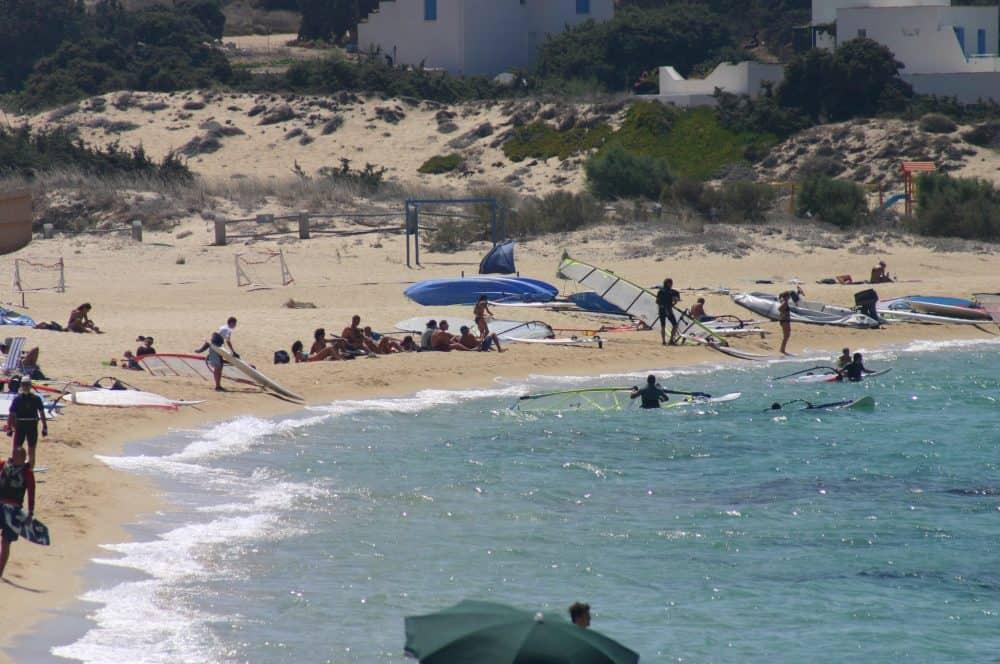 Windsurfers on the beach at Brunobarato, Naxos, Greece.