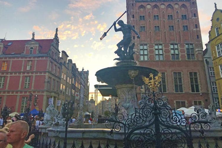 The 17th-century Neptune Fountain is a busy tourist gathering spot in Gdansk, Poland.