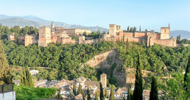The Alhambra from the Mirador San Nicolas, Granada, Spain. This is one of the seven college towns that are great places to retire on the cheap.