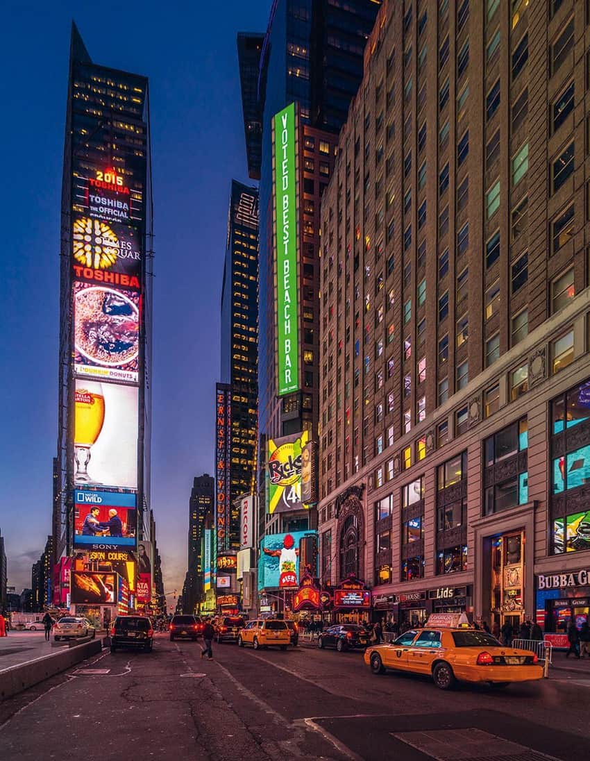 Scene from a stroll through Manhattan—larger-than-life video screens and billboards from a pedestrian's perspective.