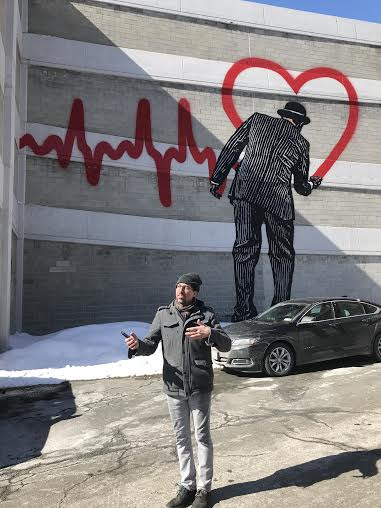 Tony Ladicicco shows off a mural by one of the Albany Art Institutes better known artists, Nick Walker