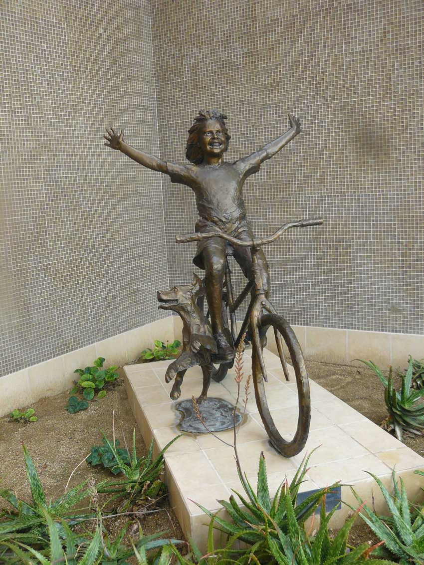 'Freewheeling' by Gary Lee Price -- one of the many engaging sculptures on El Paseo