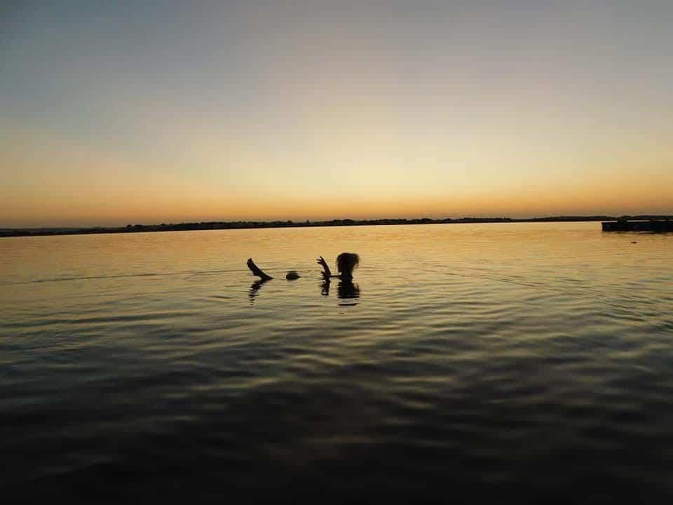 Swimming in salty Lake Siwa.