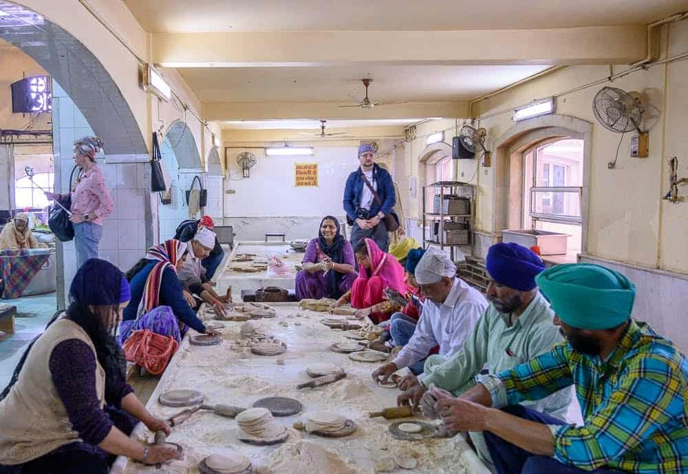 Volunteers are welcome to help out in the Langar (community kitchen), including the task of the rolling out chapati dough.