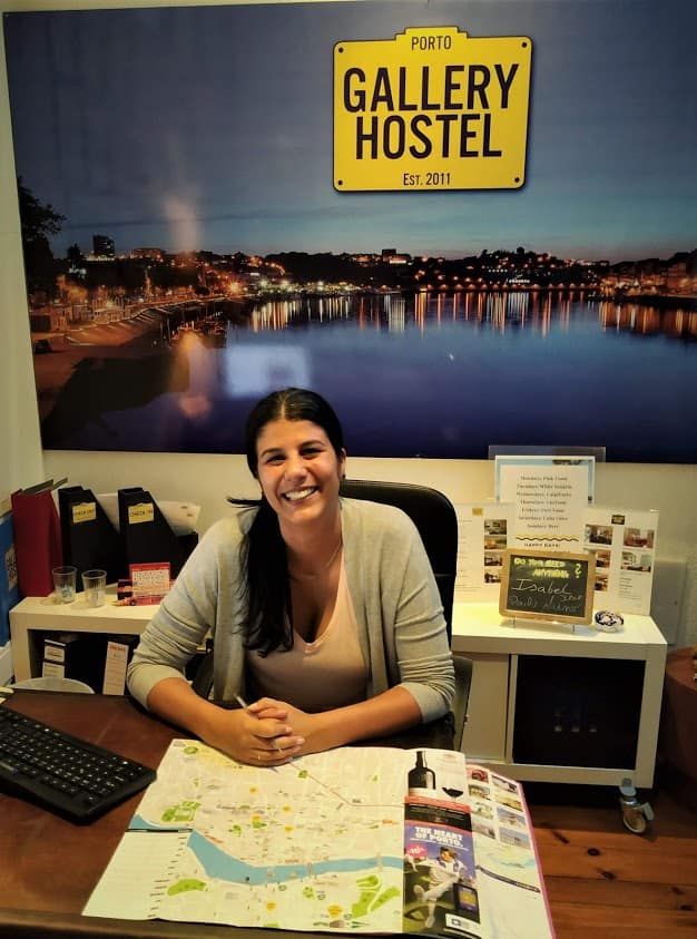 Concierge ready to assist at the Gallery Hostel in Porto, Portugal.