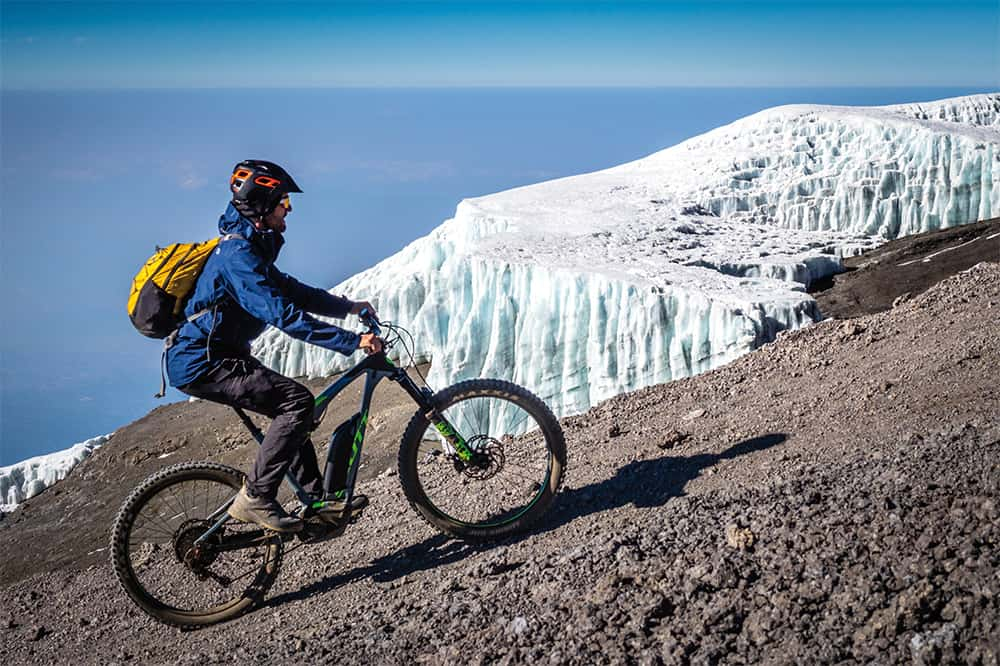 With the e-Bike on almost 6000 meters at Kilimanjaro in Africa