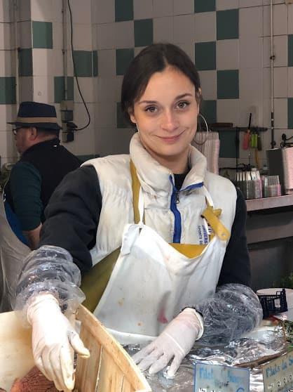 Fishmonger in the Versailles Market.