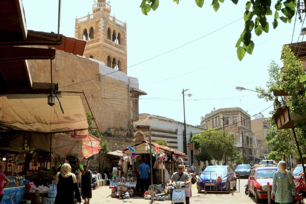 The minaret of the 13th-century Great Mansouri Mosque peers out near one of the entrances of the souks of Tripoli.